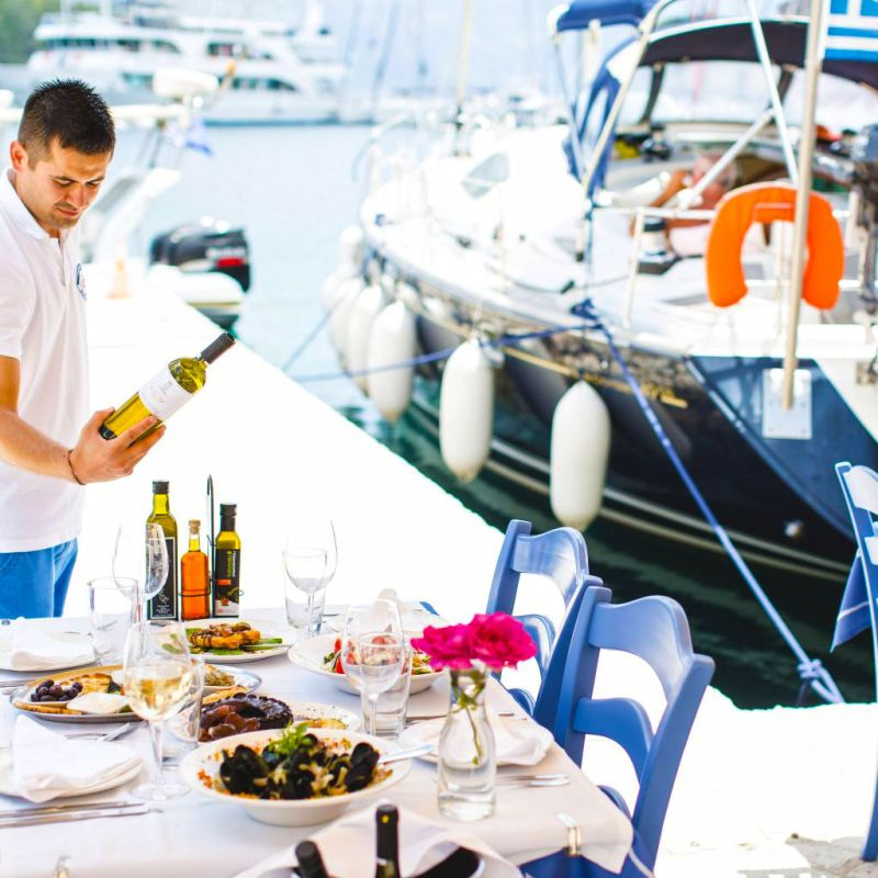 Fresh seafood and greek wine by the Sea