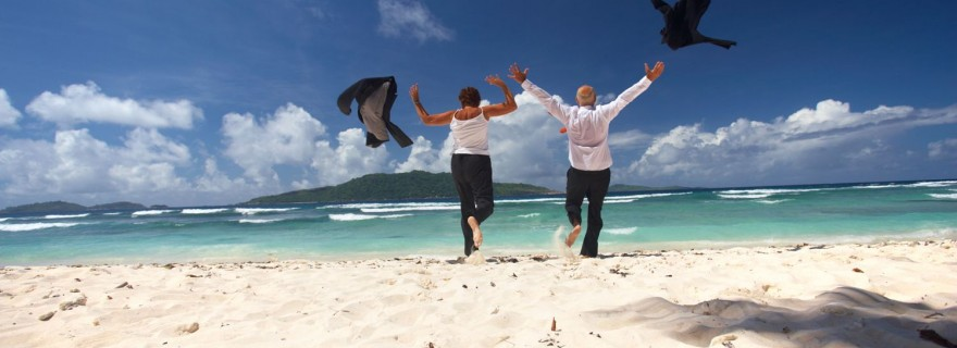 business_people_throwing_off_jackets_on_the_beach